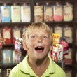 Excited Boy Standing In Sweet Shop — Stock Photo #4841237