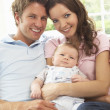 Parents Cuddling Newborn Baby Boy At Home — Stock Photo