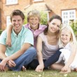 Family Sitting In Garden Together — Stock fotografie #4841403