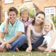 Family Sitting In Garden Together — Stockfoto #4841403