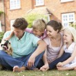 Family Sitting In Garden Together — Stock fotografie #4841405