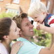 Family Playing Together In Garden At Home — Stock Photo #4841406