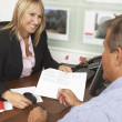 Female Estate Discussing Property Details With Client — Stockfoto