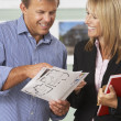 Female Estate Discussing Property Details With Client — Stock Photo #4841437