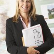 Business woman holding reports - Foto Stock