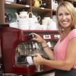 Stock Photo: Woman Working Behind Counter
