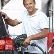 Stock Photo: Detail Of Male Motorist Filling