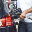 Detail Of Male Motorist Filling - Stock Photo