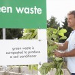 Man At Recycling Centre Disposing Of Garden Waste — Stock Photo #4841514