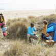 Stock Photo: Young Family Relaxing On Beach Camping Holiday