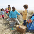 Young Family Relaxing On Beach Camping Holiday — Stock Photo