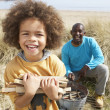 Stock Photo: Father And Son Collecting Firewood On Beach Camping Holiday