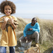 Father And Son Collecting Firewood On Beach Camping Holiday — Stock Photo