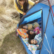 Young Family Relaxing Inside Tent On Camping Holiday — Stock Photo #4841564