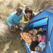 Stock Photo: Young Family Relaxing Inside Tent On Camping Holiday
