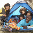 Young Family Relaxing Inside Tent On Camping Holiday — Stock Photo #4841569