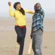 Young Couple Playing Cricket On Autumn Beach Holiday — Stock Photo