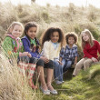 Stock Photo: Group Of Children Playing In Field Together