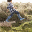 Stock Photo: Young Boy Going For Walk In Wellington Boots