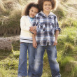 Stock Photo: Boy And Girl Playing In Field Together