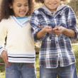 Stock Photo: Children Holding Worm Outdoors