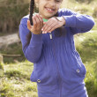 Young Girl Holding Worm Outdoors - Stock Photo