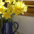 Royalty-Free Stock Photo: Vase Of Daffodils In Blue Jug On Window Sill