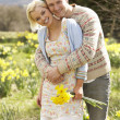 Romantic Couple Walking Amongst Spring Daffodils — Stock Photo #4841851