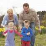 Family Having Egg And Spoon Race — Stock Photo #4841858