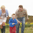 Family Having Egg And Spoon Race — Stockfoto