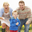 Family Having Egg And Spoon Race - Stock Photo
