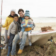 Family Group Sitting On Boat With Fishing Rod On Winter Beach — Stock Photo
