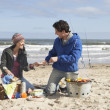 Couple Having Barbeque On Winter Beach — Stock Photo