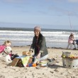 Stock Photo: Family Having Barbeque On Winter Beach