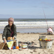 Stock Photo: Family Having Picnic On Winter Beach