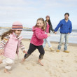 Family Walking Along Winter Beach — Stock Photo #4842000