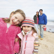 Family Walking Along Winter Beach — Stock Photo #4842008