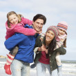 Family Walking Along Winter Beach — Stock Photo #4842010