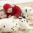 Two Girls On Beach With Pet Dog - Stock Photo