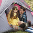 Young Family Relaxing Inside Tent On Camping Holiday — Stock Photo #4842020