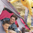 Young Family Relaxing Inside Tent On Camping Holiday — Stock Photo #4842029