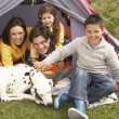 Young Family With Dog Relaxing Inside Tent On Camping Holiday — Stock Photo