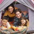 Young Family Relaxing Inside Tent On Camping Holiday — 图库照片