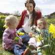 Mother And Daughter In Daffodil Field With Decorated Easter Eggs — Stock Photo #4842063
