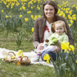 Mother And Daughter In Daffodil Field With Decorated Easter Eggs — Stock Photo #4842065
