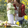 Mother And Daughter In Daffodil Field With Decorated Easter Eggs — Stock Photo #4842067