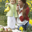 Mother And Daughter In Daffodil Field With Decorated Easter Eggs — Stock Photo
