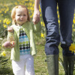 Stock Photo: Mother And Daughter In Daffodil Field With Decorated Easter Eggs
