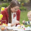 Mother And Daughter Painting Easter Eggs In Gardens — Stock Photo