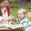 Mother And Daughter Painting Easter Eggs In Gardens — Stock Photo #4842097